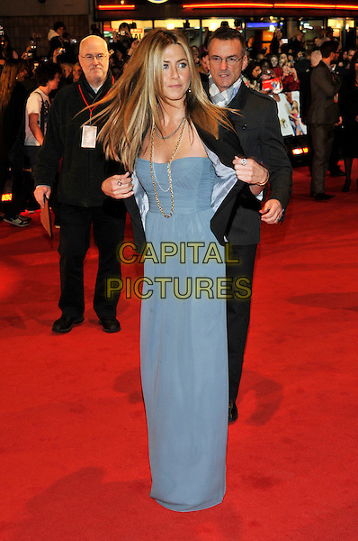 "JENNIFER ANISTON.""Marley & Me"" UK film premiere held at .Vue cinema, Leicester Square, London, England,  2nd March 2009..And full length grey gray blue long maxi dress strapless gold necklaces chains black jacket blazer taking off Burberry silk floor-length georgette .CAP/PL.©Phil Loftus/Capital Pictures"