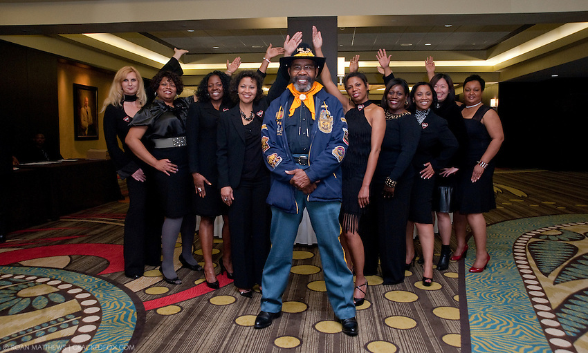 Ed Udell takes command front and center at parade rest with the PDK Sorority -Gala Volunteers.