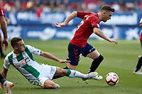 Kike Barja (forward; CA Osasuna) and Quezada (defender; Córdoba CF) during the Spanish football of La Liga 123, match between CA Osasuna and Cordoba CF at the Sadar stadium, in Pamplona (Navarra), Spain, on Saturday, October 13, 2018.