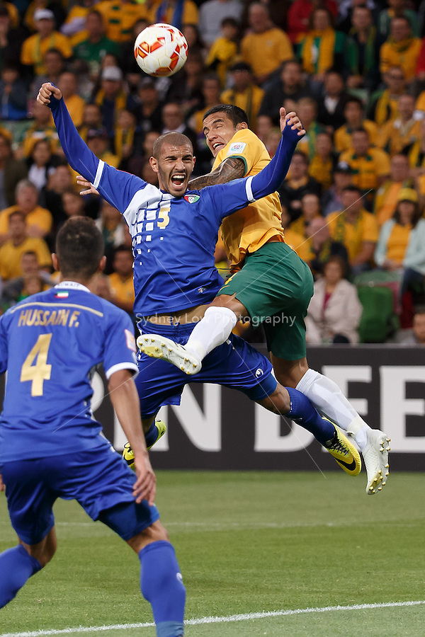 FAHAD ALHAJERI of Kuwait and Tim CAHILL of Australia jump for the ball in match 1 of the 2015 AFC Asian Cup at the Melbourne Rectangular Stadium on 9 January 2015. Australia def Kuwait 4-1