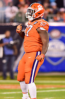 Charlotte, NC - DEC 2, 2017: Clemson Tigers defensive tackle Albert Huggins (67) celebrates a sack on Miami Hurricanes quarterback Malik Rosier (12) during ACC Championship game between Miami and Clemson at Bank of America Stadium Charlotte, North Carolina. (Photo by Phil Peters/Media Images International)