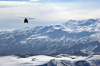 A CH-47 Chinook helicopter from Combined Joint Task Force 76 carries troops and supplies over mountains in eastern Afghanistan Feb. 5, 2007. DoD photo by Staff Sgt. Michael L. Casteel, U.S. Army. (Released)