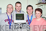 MONITOR: Dublin City marathon runners Colm Nix, Castleisland, Willie Cotter, Knocknagoshel, and Francie Brosnan, Castleisland, who raised 10,050, which was used to buy a MP 30 Neo Nagle monitor for the Emly Childrens Ward in Kerry General Hospital, get a display of the new unit from Nurse Jackie McCull last Tuesday..