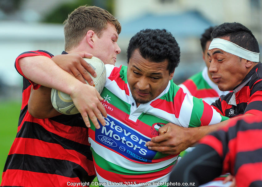 Action from the Wellington Club Rugby Swindale Shield match between Hutt Old Boys Marist (red, green and white hoops) and Poneke (red and black hoops) at Hutt Rec, Wellington, New Zealand on Saturday, 16 May 2015. Photo: Dave Lintott / lintottphoto.co.nz
