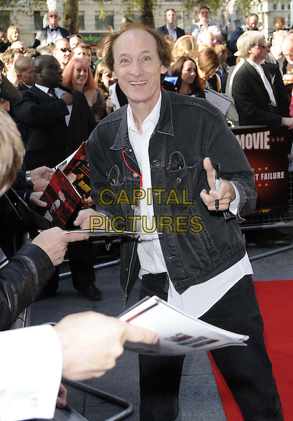 John Otway.The 'Otway: The Movie' UK film premiere, Odeon Leicester Square cinema, Leicester Square, London, England..October 7th, 2012.half length black jeans denim jacket white shirt signing autographs .CAP/CAN.©Can Nguyen/Capital Pictures.