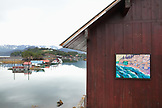 ALASKA, Homer, a painting hangs on the exterior wall of an art gallery, Halibu Cove