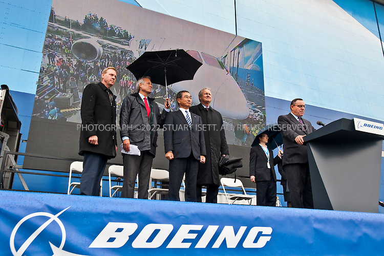 9/26/2011--Everett, WA, USA..Scott Fancher, general manager of the 787 program for Boeing Co., makes closing comments at events for the delivery of the company's first 787 Dreamliner...Thousands of Boeing employees gathered in the rain to celebrate the delivery of the first 787 Dreamliner to launch customer ANA (All Nippon Airways) from Japan. The fuel efficient composite aircraft was towed to the front of the huge factory doors where it was assembled, and presented to ANA President Shinichiro Ito in front of thousands of invited dignitaries and Boeing workers. The first 787 was supposed to be delivered 3 years ago but despite delays Boeing still has orders for over 800 of the planes...©2011 Stuart Isett. All rights reserved.