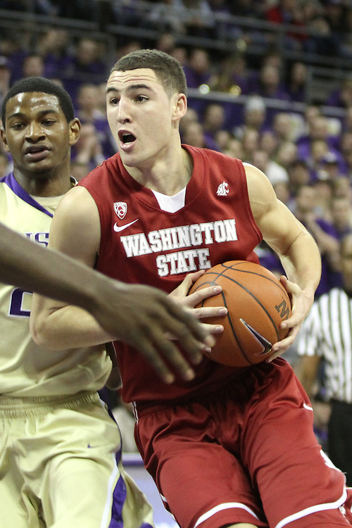 Klay Thompson, Washington State junior guard, drives to the hoop for two of his 26 points during the Cougars 80-69 road victory over arch-rival Washington at the Alaska Airlines Arena in Seattle, Washington, on February 27, 2011.  With the victory, Thompson and the Cougars swept the regular season series from the Huskies, two games to none.