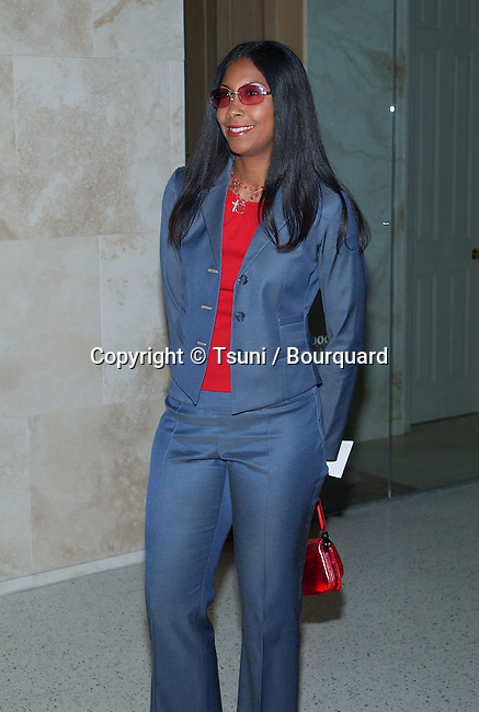 Cookie Johnson (Magic's wife) arriving at the Sunshine State premiere at the Pacific Design center in Los Angeles. June 18, 2002.           -            JohnsonCookie_Magic'swife03.jpg