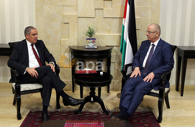 Palestinian Prime minister, Rami Hamdallah, meets with EU representative to Palestine Ralph Trav, in the West Bank city of Ramallah, on August 23, 2017. Photo by Prime Minister Office