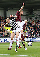 Marius Zaliukas challenging Marc McAusland in the St Mirren v Heart of Midlothian Clydesdale Bank Scottish Premier League match played at St Mirren Park, Paisley on 15.9.12.