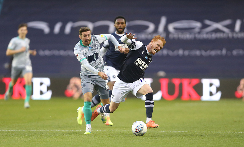 Blackburn Rovers' Joe Rothwell and Millwall's Ryan Woods<br /> <br /> Photographer Rob Newell/CameraSport<br /> <br /> The EFL Sky Bet Championship - Millwall v Blackburn Rovers - Tuesday July 14th 2020 - The Den - London<br /> <br /> World Copyright © 2020 CameraSport. All rights reserved. 43 Linden Ave. Countesthorpe. Leicester. England. LE8 5PG - Tel: +44 (0) 116 277 4147 - admin@camerasport.com - www.camerasport.com