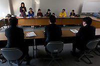 Officials from METI listen and make notes as as organizers of the Anti nuclear protest by women outside the Ministry of Economy, Trade and Industry (METI) visit to present their demands. Tokyo Japan. Friday November 4th 2011. The protest ran from October 27th to Noverber 5th. Originally started my mothers from Fukushima protesting about nuclear contamination from October 30th to November 5th the protest welcomed women and people from all over Japan.