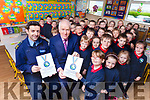 Dancing with the Stars winner Aidan O'Mahony and Jimmy Deenihan presenting certificates to the senior infants in Listellick National School on Monday morning for completing their six week marathon challenge.