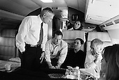 Rock Hill, Sout Carolina.USA.January 29, 2004..General Wesley Clark works with his staff to refine his speech and his postion in the debates later int he evening aboard his plane.