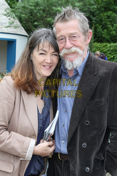 Anwen Rhys Meyers and John Hurt<br /> RHS Chelsea Flower Show Press and VIP Day at Royal Hospital Chelsea, London, England.<br /> May 21st 2012<br /> half length beige blazer black suit jacket blue shirt goatee facial hair married husband wife glasses<br /> CAP/ROS<br /> &copy;Steve Ross/Capital Pictures