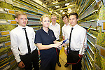 Bryony Mullins from BT demonstrates the latest technology to Mark Drakeford AM Minister for Health and Social Services and BT apprentices Liam Lewis, Chris Rutter  &amp; Harrison Burke during a visit to Stadium House in Cardiff.<br /> <br /> 12.07.13<br /> &copy;Steve Pope-Fotowales