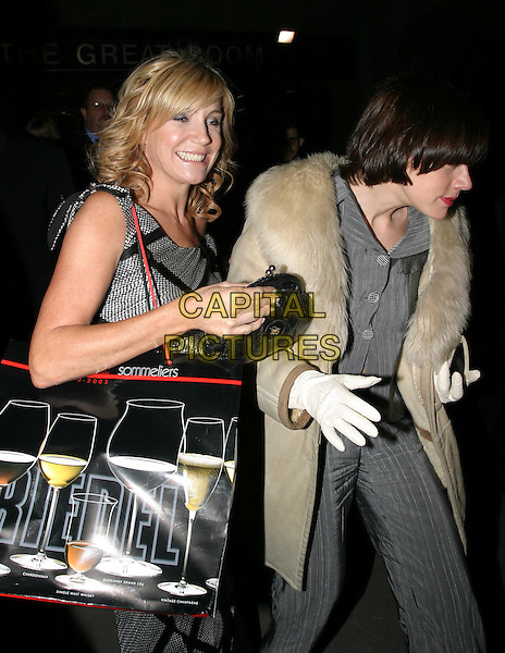 MICHELLE COLLINS  .The Tio Pepe/Carlton London Restaurant Awards 2004.Grosvenor House.08 March 2004.drunk, funny, goody bag, goodie bag.www.capitalpictures.com.sales@capitalpictures.com.© Capital Pictures.