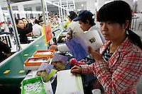 Workers assembling Hannah Montana cards at the Jetta Company Ltd. in Guangzhou, China. The four-month-long crackdown in 2007 was triggered by widespread reports of dangerous or faulty Chinese exports, including toys tainted with lead, toothpaste laden with an antifreeze ingredient, and pet food fortified with an industrial chemical..20 Dec 2007
