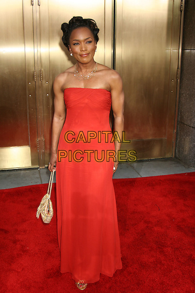 ANGELA BASSETT.Attends the 59th Annual Tony Awards - Red Carpet.Radio City Music Hall in New York City, USA,.June 5th 2005..full length strapless red dress.Ref: IW.www.capitalpictures.com.sales@capitalpictures.com.©Ian Wilson/Capital Pictures.
