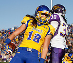 BROOKINGS, SD - OCTOBER 24:  Connor Landberg #18 from South Dakota State celebrates a touchdown in front of D'Shawn Dexter #30 from University of Northern Iowa in the third quarter of their game Saturday afternoon at Coughlin Alumni Stadium in Brookings. (Photo by Dave Eggen/Inertia)