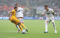Preston North End's Lukas Nmecha under pressure from Swansea City's Tom Carroll and Joe Rodon<br /> <br /> Photographer Kevin Barnes/CameraSport<br /> <br /> The EFL Sky Bet Championship - Swansea City v Preston North End - Saturday August 11th 2018 - Liberty Stadium - Swansea<br /> <br /> World Copyright &copy; 2018 CameraSport. All rights reserved. 43 Linden Ave. Countesthorpe. Leicester. England. LE8 5PG - Tel: +44 (0) 116 277 4147 - admin@camerasport.com - www.camerasport.com