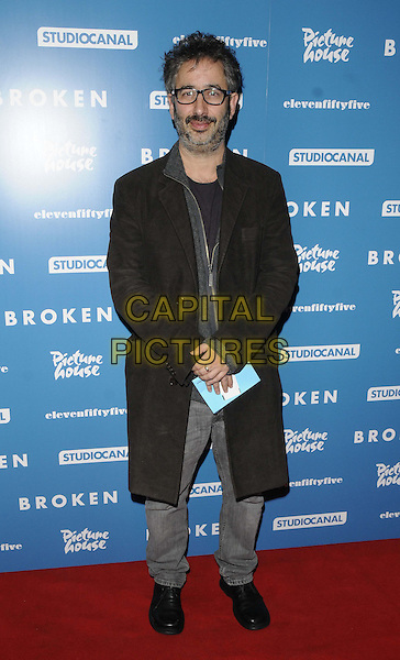 "David Baddiel.attended the ""Broken"" UK film premiere, Hackney Picturehouse, Mare St., London, England..March 4th, 2013.full length black coat beard facial hair glasses trousers  grey gray.CAP/CAN.©Can Nguyen/Capital Pictures."