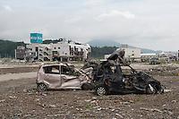 Landscape view of damaged vehicles in Rikuzentakata City following the 311 Tohoku Tsunami in Rikuzentakata, Japan  © LAN