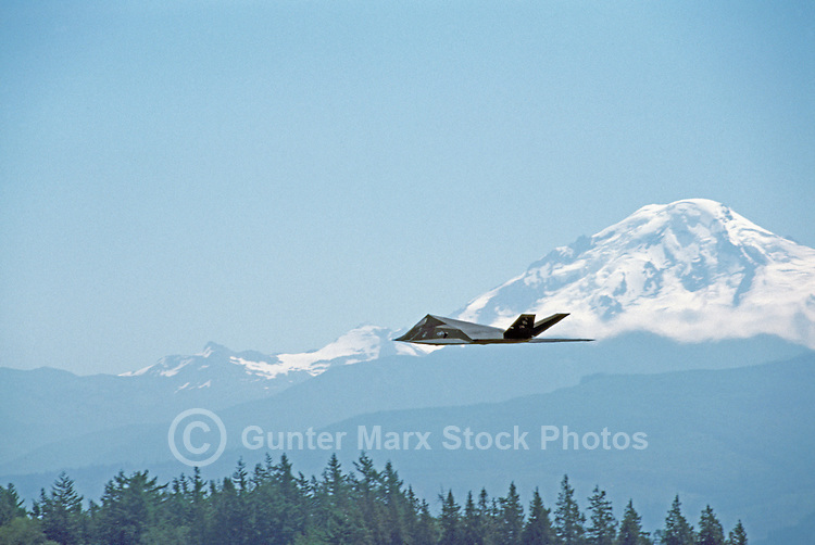 US Air Force Lockheed F-117A Nighthawk Stealth Fighter flying past Mt. Baker, USA - at Abbotsford International Airshow, BC, British Columbia, Canada