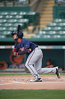 GCL Twins shortstop Estamy Urena (15) follows through on a swing during the first game of a doubleheader against the GCL Orioles on August 1, 2018 at CenturyLink Sports Complex Fields in Fort Myers, Florida.  GCL Twins defeated GCL Orioles 7-6 in the completion of a suspended game originally started on July 31st, 2018.  (Mike Janes/Four Seam Images)