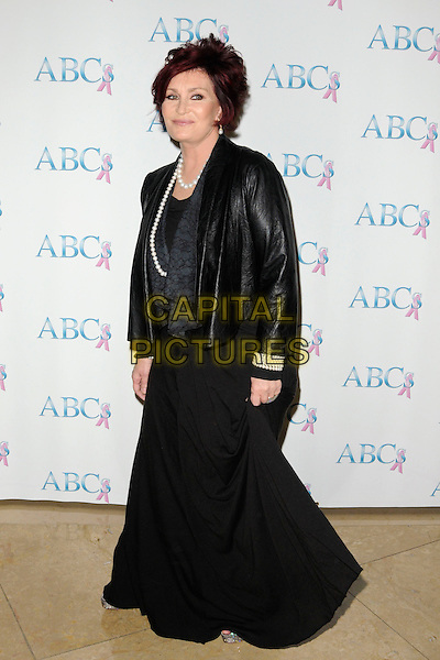 SHARON OSBOURNE .The Associates for Breast and Prostate Cancer 20th Anniversary Gala at the Beverly Hilton Hotel in Beverly Hills, California, USA..November 21st, 2009.full length black dress jacket leather pearl necklace .CAP/ROT.©Lee Roth/Roth Stock/Capital Pictures
