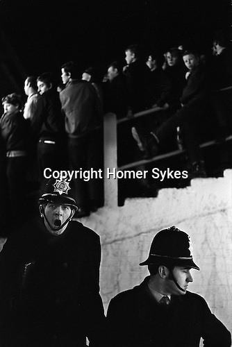 The Shed at Chelsea Football ground. London. Police on duty.