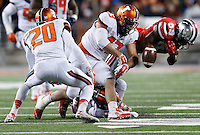 Illinois Fighting Illini linebacker Mason Monheim (43) causes a fumble as he tackles Ohio State Buckeyes wide receiver Jeff Greene (89) in the fourth quarter the college football game between the Ohio State Buckeyes and the Illinois Fighting Illini at Ohio Stadium in Columbus, Saturday night, November 1, 2014. The Ohio State Buckeyes defeated the Illinois Fighting Illini 55 - 14. (The Columbus Dispatch / Eamon Queeney)