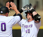 SIOUX FALLS, SD - MARCH 20: Austin Richey #41 from the University of Sioux Falls gets a high five from coach Grant Hieb #20 after driving in two runs against Minnesota Duluth Friday afternoon at Harmodon Park in Sioux Falls.  (Photo by Dave Eggen/Inertia)