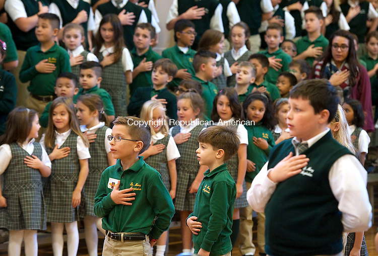 WATERTOWN,  CT-110716JS01- Students lead guests in the Pledge of Allegiance during the second annual Veteran's Day prayer service held Monday at St. Mary Magdalene school in Watertown.    Jim Shannon Republican American