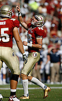 TALLAHASSEE, FL 9/18/10-FSU-BYU FB10 CH-Florida State's Dustin Hopkins celebrates a point after touchdown against Brigham Young during first half action Saturday at Doak Campbell Stadium in Tallahassee. .COLIN HACKLEY PHOTO