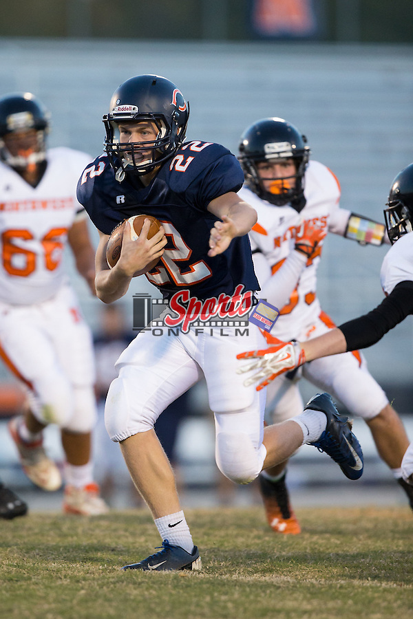 Nathan Yow (22) of the Carson Cougars runs with the football during first half action against the Northwest Cabarrus Trojans at Jesse Carson High School on October 24, 2014, in China Grove, North Carolina.  The Cougars defeated the Trojans 35-6.  (Brian Westerholt/Sports On Film)