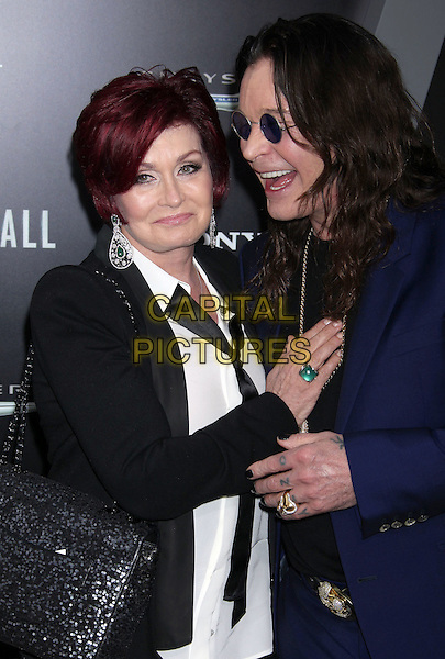 Sharon Osbourne, Ozzy Osbourne.Premiere of 'Total Recall' held at The Grauman's Chinese Theatre in Hollywood, California, USA..August 1st, 2012.half length  black suit jacket blue suit sunglasses shades married husband wife smiling profile laughing .CAP/ADM/RE.©Russ Elliot/AdMedia/Capital Pictures.