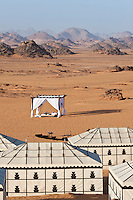 View from the tents of the desert camp to the distant moon-like rock formations