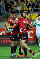 Bryn Hall (left) and George Bridge (right) congratulate David Havili on his first try during the Super Rugby match between the Hurricanes and Crusaders at Westpac Stadium in Wellington, New Zealand on Friday, 29 March 2019. Photo: Dave Lintott / lintottphoto.co.nz