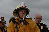 Monday December 8, 2008:  University City, San Diego California.  Fire Chief Tracy Jarman address the media as Police Chief Willian Landsdowne looks on the scence where a military jet crashed into a residential home killing at least 2 civilians.  At approximately 11:59am a USMC F-18 fighter jet encountered trouble over this residential area of the city and the pilot ejected leaving his aircraft to crash into a residential neighborhood.