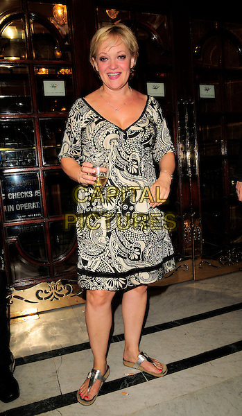 "MARIA FRIEDMAN.The ""Lyrics by Don Black"" 70th birthday concert, London Palladium, Argyll Street, London, England..August 17th, 2008.full length black white silver flip flops drink beverage champagne dress pattern paisley print .CAP/CAN.©Can Nguyen/Capital Pictures."