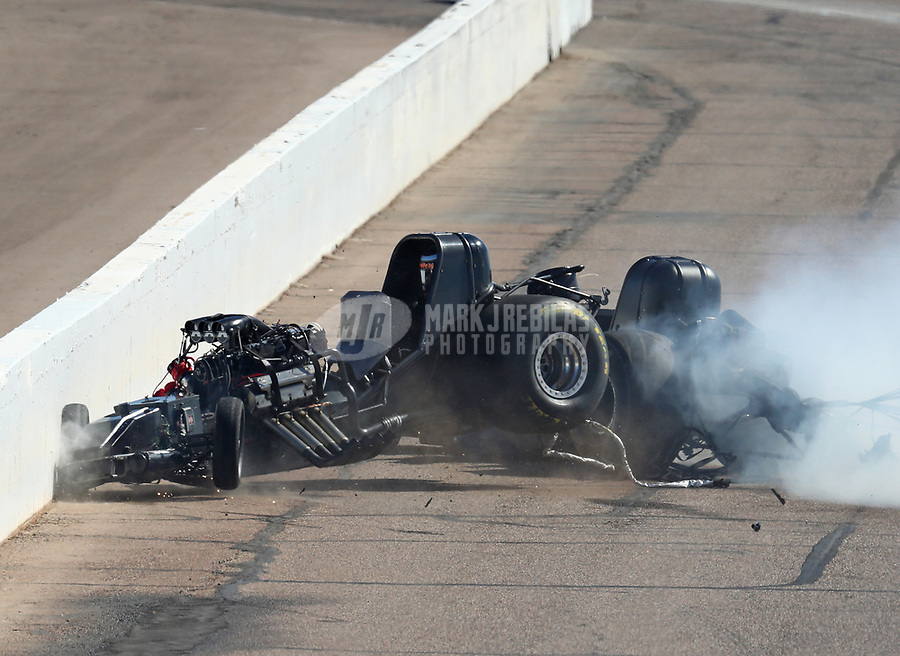 Feb 25, 2018; Chandler, AZ, USA; NHRA funny car driver John Force (right) crashes with Jonnie Lindberg during the Arizona Nationals at Wild Horse Pass Motorsports Park. Mandatory Credit: Mark J. Rebilas-USA TODAY Sports