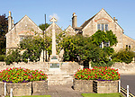 Historic Cotswold stone buildings and war memorial in Canon Square, Melksham, Wiltshire, England, UK