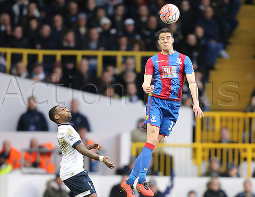 21.02.2016. White Hart Lane, London, England. Emirates FA Cup 5th Round. Tottenham Hotspur versus Crystal Palace. Martin Kelly jumps and heads the ball away from Rose