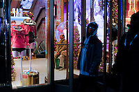 A man waits inside of a store decorated for Christmas holidays in New York, 12/9/2015 Photo by VIEWpress