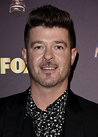 WEST HOLLYWOOD, CA - DECEMBER 13: Panelist Robin Thicke attends the premiere karaoke event for season one of THE MASKED SINGER on Thursday, Dec.13 at The Peppermint Club in West Hollywood, California. (Photo by Scott Kirkland/FOX/PictureGroup)