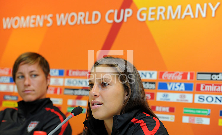Abby Wambach (l) and Carli Lloyd of team USA at a press conference during the FIFA Women's World Cup at FIFA Stadium in Dresden, Germany on July 9th, 2011.