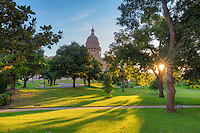 The sun peeks through the trees at sunrise in the Texas State Capitol grounds. This morning was aperfect start to the day in downtown Austin, and a hint of Autumn was in the air.