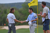 Tommy Fleetwood (ENG) congratulates Louis Oosthuizen (RSA) for winning their match on 15 during day 3 of the WGC Dell Match Play, at the Austin Country Club, Austin, Texas, USA. 3/29/2019.<br /> Picture: Golffile | Ken Murray<br /> <br /> <br /> All photo usage must carry mandatory copyright credit (© Golffile | Ken Murray)